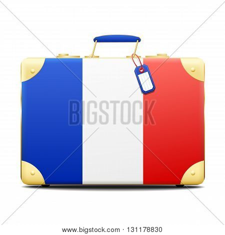 Patriotic French suitcase in the red white and blue colors of the tricolor national flag of France with a small blank name tag and brass fittings over white with a shadow