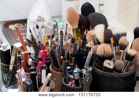 LITHUANIA MAZEIKIAI - MAY 21 2016: Used makeup brushes and cosmetics in beauty salon