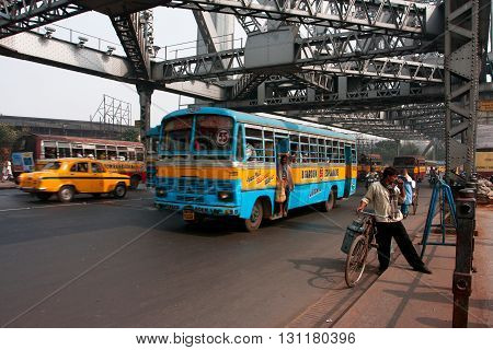 KOLKATA, INDIA - JAN 18, 2013: People and transport traffic on the famous Howrah bridge on January 18, 2013 in Kolkata India. Howra bridge bears 100000 vehicles and more than 150000 pedestrians every day