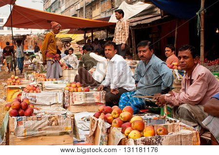 KOLKATA, INDIA - JAN 14, 2013: Fruit market sellers wait for the customers at the bright day on January 14, 2013 in Kolkata. Only 0.81 perc of the Kolkata's workforce employed in the primary sector - agriculture