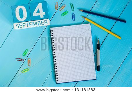 September 4th. Image of september 4 wooden color calendar on white background workplace. Autumn day.