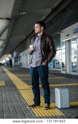 Portrait of a young man waiting at airport