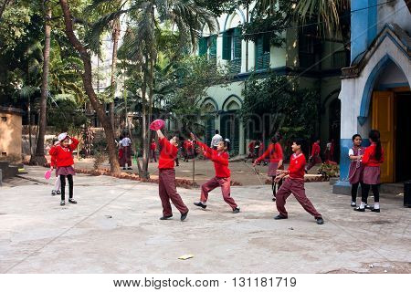 KOLKATA, INDIA - JAN 17, 2013: Unidentified school children play frisbee outdoor on January 17, 2013 in Kolkata West Bengal India. West Bengal state has 18 universities and 136 affiliated colleges