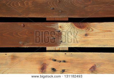 Planks partly painted with brown paint background