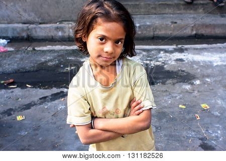 KOLKATA, INDIA - JAN 17, 2015: Unidentified child looks calm and happy on January 17, 2015 in West Bengal. Kolkata's literacy rate of 87.14 perc. exceeds the all-India average of 74 perc