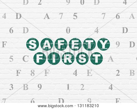 Safety concept: Painted green text Safety First on White Brick wall background with Hexadecimal Code