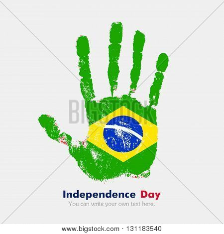 Hand print, which bears the Flag of Brazili. Independence Day. Grunge style. Grungy hand print with the flag. Hand print and five fingers. Used as an icon, card, greeting, printed materials.