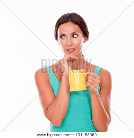 Worried Brunette Woman With Coffee Mug