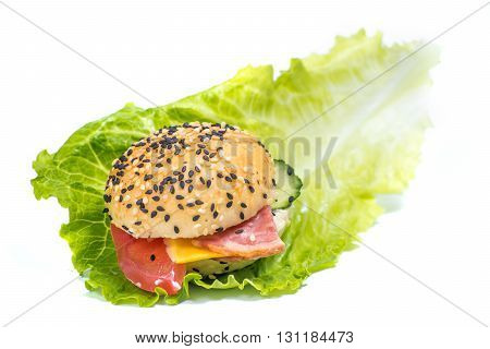 small hamburger  with vegetables and bacon on a white background