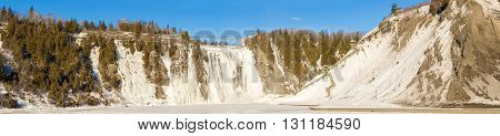 The Montmorency Falls is a large waterfall on the Montmorency River in Quebec. The falls are located about 12 km from the heart of old Quebec City. The falls at 84 meters high and 46 meters wide are the highest in the province of Quebec. They are 30 meter