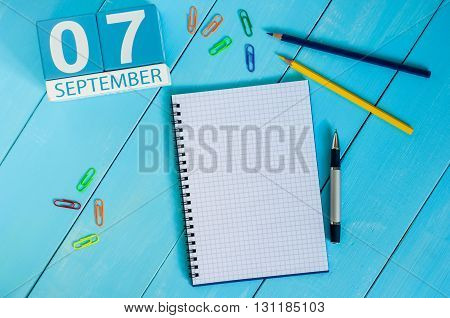 September 7th. Image of september 7 wooden color calendar on white background. Autumn day. Empty space for text.