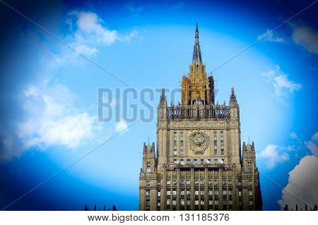 MOSCOW, RUSSIA - May 23, 2016: Building of Russian Foreign Ministry in Moscow background of blue sky with clouds. Vignette.