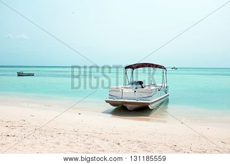 Boats on the beach at Palm Beach on Aruba island in the Caribbean
