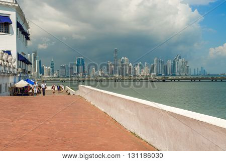 Panama city Panama - November 23 2015: People walking in old part of Panama city and the skyscrapers skyline at the background