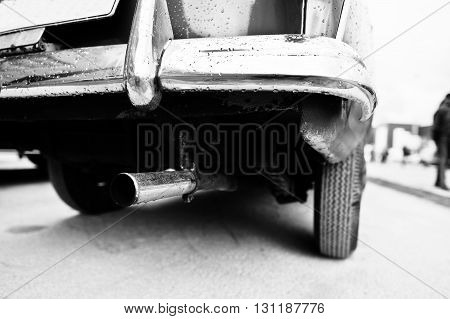 Closeup Exhaust Pipe Of Old Vintage Car. Black And White Photo