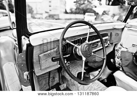 Wooden Interior And Steering Wheel On Old Vintage Retro Car. Black And White Photo