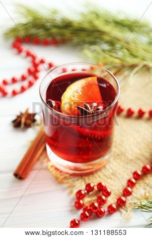 Mulled Wine In Glass On White Wooden Table