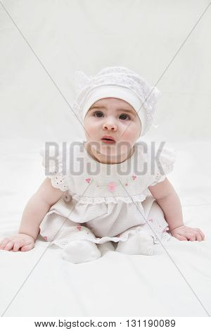 infant baby girl age ten months on a white background