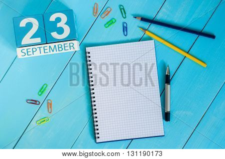 September 23rd. Image of september 23 wooden color calendar on white background. Autumn day. Empty space for text.