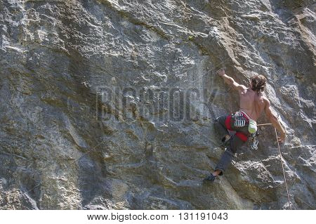 handsome Mature climber man on the wall.