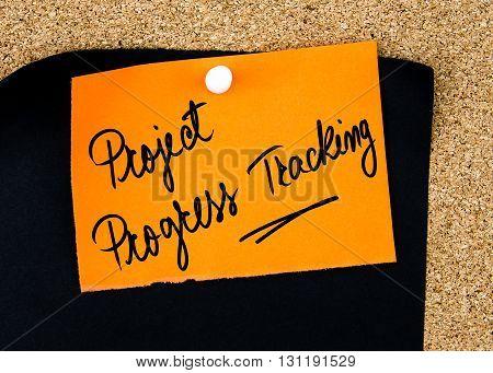 Project Progress Tracking Written On Orange Paper Note