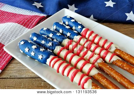 Fourth Of July American Flag Themed Pretzel Rods On Plate With Holiday Decor