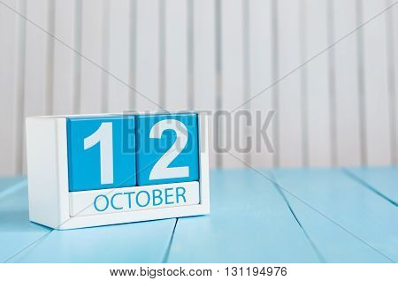 October 12th. Image of October 12 wooden color calendar on white background. Autumn day. Empty space for text.