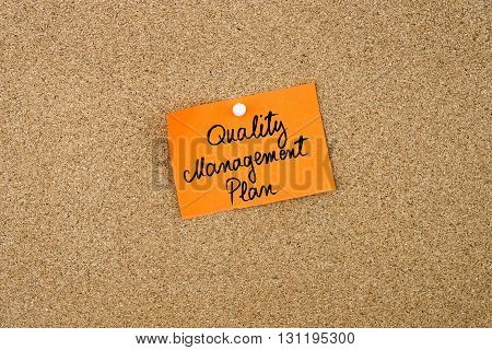 Quality Management Plan Written On Orange Paper Note