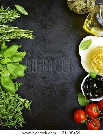 Traditional Ingredients Of Italian Cuisine On A Black Background.top View.