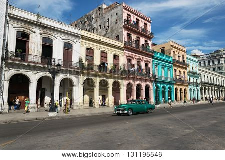 Havana, Cuba - June 23, 2015: Classic car passing by typical colonial buildings in Old Havana