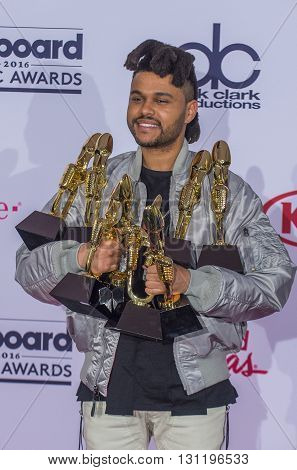 LAS VEGAS - MAY 22 : Recording artist The Weeknd poses in the press room at the 2016 Billboard Music Awards at T-Mobile Arena on May 22 2016 in Las Vegas Nevada.