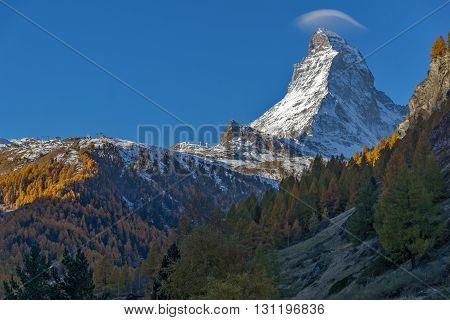 First Rays of Sun over Matterhorn peak, view from Zermatt, Canton of Valais, Switzerland