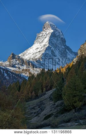 Small cloud over Matterhorn peak, view from Zermatt, Canton of Valais, Switzerland