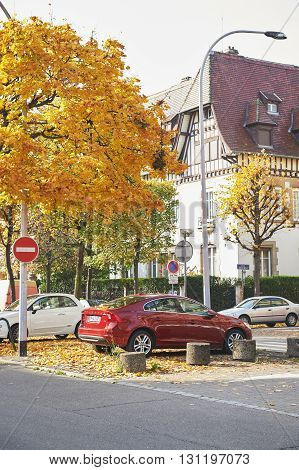 STRASBOURG FRANCE - OCT 30 2016: Luxury Volvo S60 sedan car parked under a yellow autumn tree