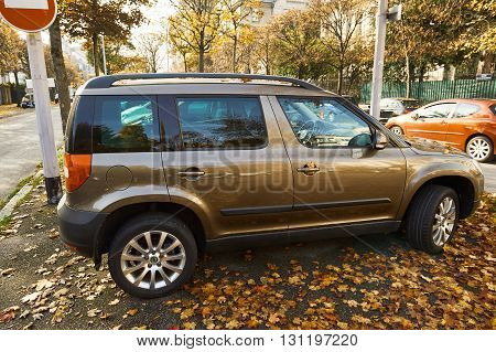 STRASBOURG FRANCE - OCT 30 2015: Maroon metallic Skoda Yeti 4*4 all terrain urban vehicle parked in autumn city