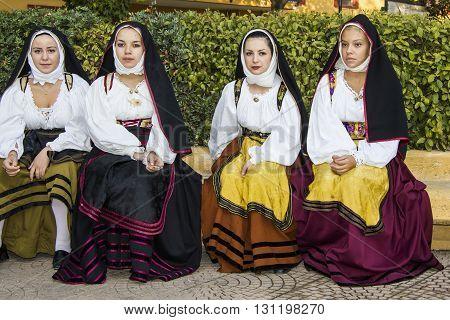 SELARGIUS, ITALY - September 9, 2012: Former marriage Selargino - Sardinia - group of girls with a traditional Sardinian costume