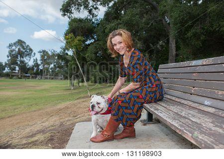 Attractive English Bulldog owner smiling over left shoulder.