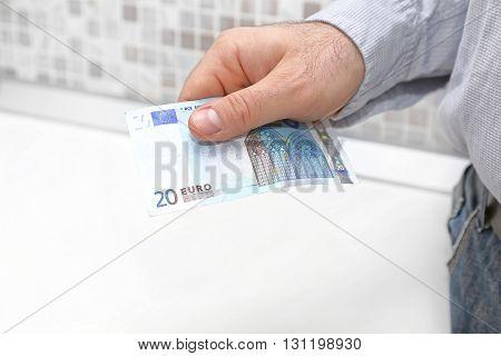 Twenty Euro Bill in Man Hand Paying