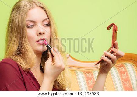 Attractive Woman Applying Lipstick. Make Up.