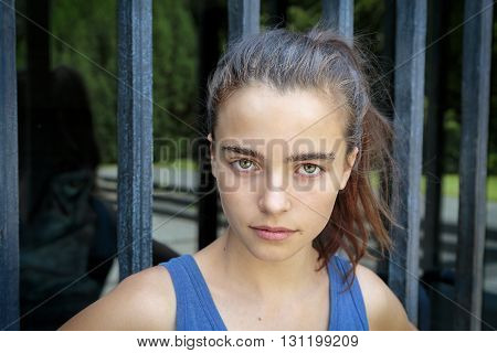 portrait of a beautiful serious teenage girl