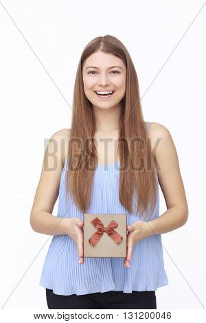 Young woman portrait holding gift on white background