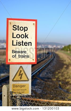 Stop look and listen train crossing warning sign