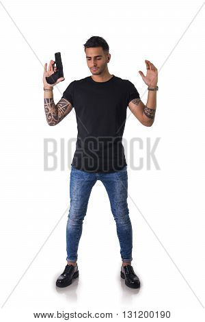 Portrait of detained tattooed man with gun. Studio shot. Isolated on white background. Full length body shot