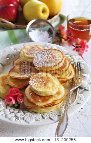 Spring sweet breakfast: apple thick pancakes and tea