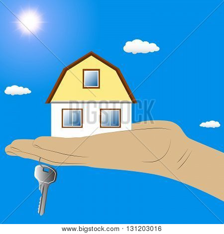 Small cottage in the hand with a key on blue sky background