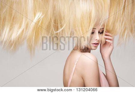 Hairstyle portrait of a young blonde