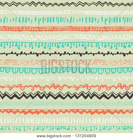 Ornamental ethnic seamless pattern. Endless hand drawn backdrop in boho style, tribal trendy ornament. Horizontal decorative colorful lines on yellow background. For cloth, wallpaper, wrapping