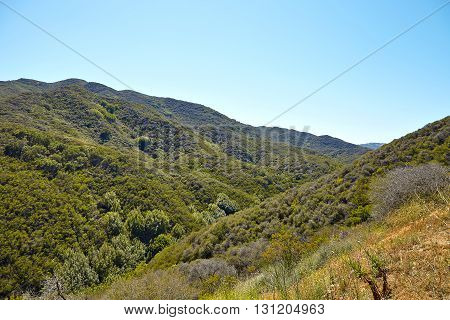 Panoramic view of meadows, hills and sky in Malibu Creek State Park, California