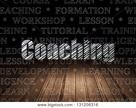 Learning concept: Glowing text Coaching in grunge dark room with Wooden Floor, black background with  Tag Cloud