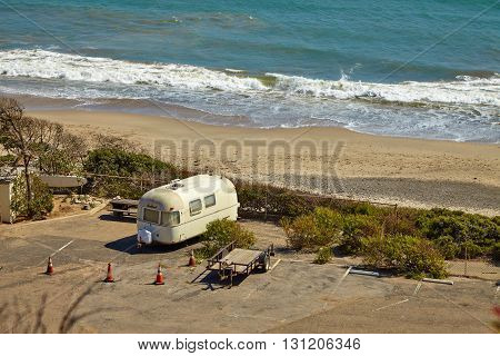 Vintage american mobile home on a camping site on the malibu beach